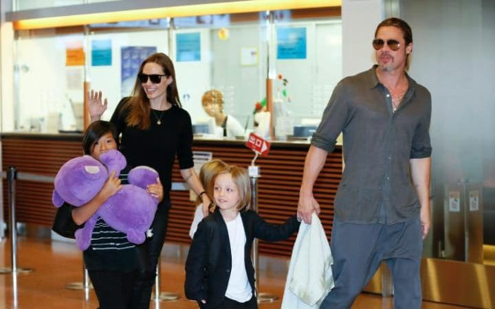 Angelina Jolie and Brad Pitt with three of their children in 2013